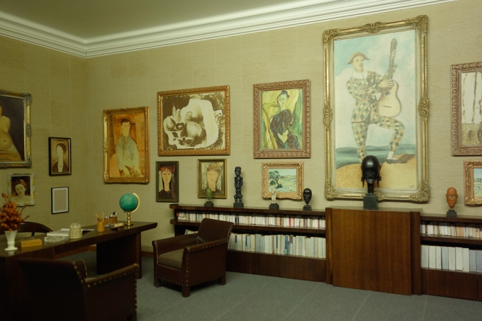 One of the miniature room s in the Orangerie, showing Paul Gilluame's collection of paintings and African art.